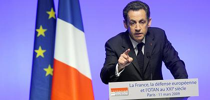 France's President Nicolas Sarkozy announces in Paris that France would rejoin NATO's integrated military command on March 11, 2009