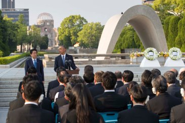 Obama speaking at a wreath-ceremony with Japanese Prime Minister Shinzo Abe at the Hiroshima Peace Memorial
